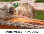 Little Girl  Looking On Guinea...