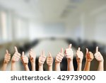 People Holding Thumbs Up In A...