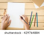 hands drawing on  paper on... | Shutterstock . vector #429764884