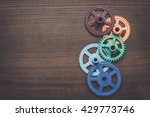 colorful gears on the brown... | Shutterstock . vector #429773746
