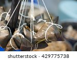 tying a wrapped dumpling in... | Shutterstock . vector #429775738
