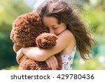 Emotional Girl Hugging Her...