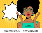 Wow pop art face. Sexy surprised african woman with open mouth, glasses in form of heart and speech bubble. Vector colorful background in pop art retro comic style. | Shutterstock vector #429780988