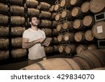 winemaker counting the barrels... | Shutterstock . vector #429834070