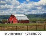 Spring Day With A Red Barn In...