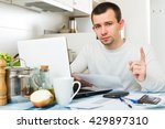 unhappy man with laptop and... | Shutterstock . vector #429897310