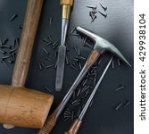 Small photo of Traditional tools of upholsterer on a table closeup