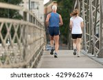 healthy mature couple jogging... | Shutterstock . vector #429962674