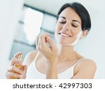 woman putting on perfume and... | Shutterstock . vector #42997303