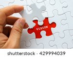 hand holding piece of puzzle... | Shutterstock . vector #429994039