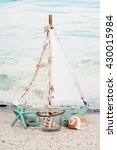 a sail boat with seashells for...   Shutterstock . vector #430015984
