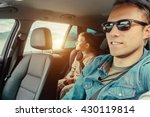 father with son sit in car | Shutterstock . vector #430119814