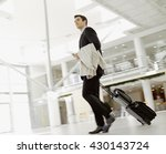 young man pulling suitcase in... | Shutterstock . vector #430143724