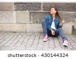 young woman sitting on the... | Shutterstock . vector #430144324