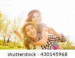 happy smiling girl piggybacking ... | Shutterstock . vector #430145968