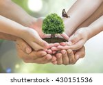 World environment day and sustainable environment concept in father - children's volunteer hands