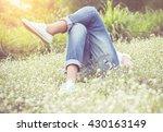 woman relaxing in a meadow in... | Shutterstock . vector #430163149