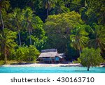 Small photo of House of Robinson Crusoe. Beautiful island with blue bay and palm trees