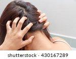 women itching scalp | Shutterstock . vector #430167289