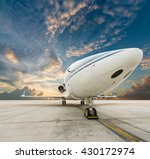 jet plane parked with nice cloud | Shutterstock . vector #430172974