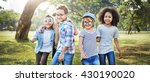 kids playing cheerful park... | Shutterstock . vector #430190020
