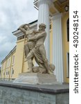 """Small photo of SAINT-PETERSBURG, RUSSIA ?? MAY 25, 2016:Sculptural group """"Abduction of Proserpine by Pluto"""" facade of the Mining Institute. Saint-Petersburg, Russia."""