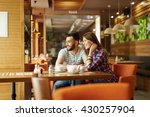 enjoying time in cafe | Shutterstock . vector #430257904