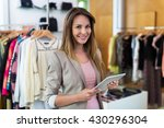 boutique owner using a digital... | Shutterstock . vector #430296304