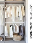 modern closet with row of white ... | Shutterstock . vector #430318654