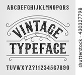 Stock vector vintage typeface retro distressed alphabet vector font hand drawn letters and numbers typeset 430327798