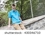 a young teen boy looking out of ... | Shutterstock . vector #430346710