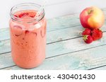 fruit smoothie on blue wooden... | Shutterstock . vector #430401430