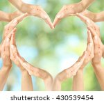 female hands in heart shape on...   Shutterstock . vector #430539454
