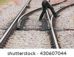 Man Crosses Railroad Rail With...