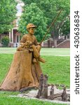 Small photo of STILLWATER, OK/USA - MAY 20, 2016: Boy and Dog Fishing Sculpture at Theta Pond on the campus of Oklahoma State University.