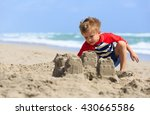Little Boy Play With Sand On...