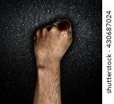man hand fist on dark...   Shutterstock . vector #430687024