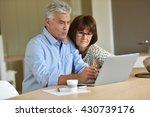 senior couple using laptop... | Shutterstock . vector #430739176