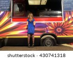 girl in front of food truck | Shutterstock . vector #430741318