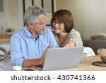 senior couple using laptop... | Shutterstock . vector #430741366