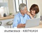senior couple using laptop... | Shutterstock . vector #430741414