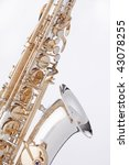 A professional gold and silver alto saxophone isolated against a white background. - stock photo