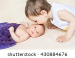 the boy kisses his newborn... | Shutterstock . vector #430884676