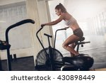 Fit Young Woman Using Exercise...