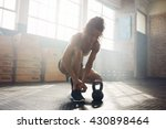 fit young woman at gym tying... | Shutterstock . vector #430898464
