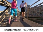 healthy mature couple jogging... | Shutterstock . vector #430955044