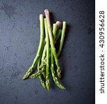 green asparagus on a black stone | Shutterstock . vector #430956628