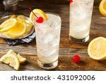 Stock photo refreshing classic tom collins cocktail with a cherry and lemon slice 431092006