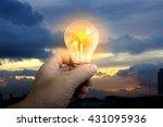 holding glowing light bulb over ... | Shutterstock . vector #431095936