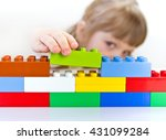 child playing with toy blocks | Shutterstock . vector #431099284